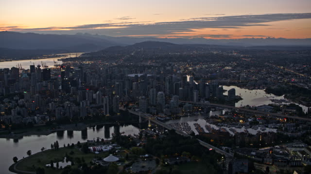 aerial city of vancouver at sundown - vancouver canada stock videos and b-roll footage