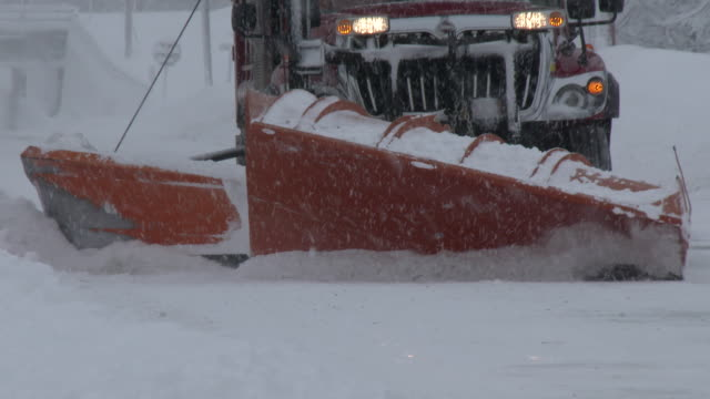 a city plow clears snow off of main street in adams new york during a heavy lake effect snowstorm - scott mcpartland stock videos and b-roll footage
