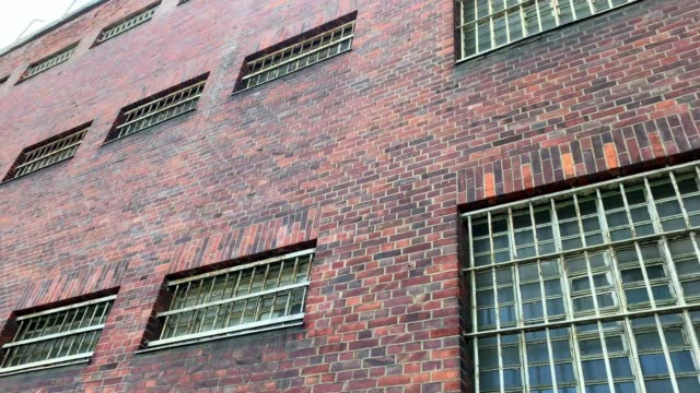 city prison with security bars in windows - prison window stock videos & royalty-free footage