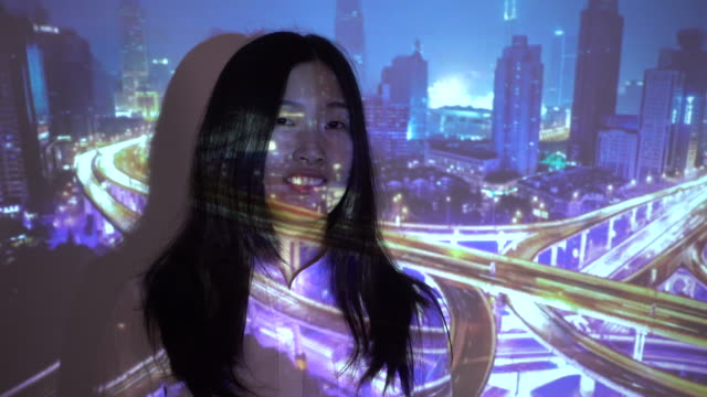 city projection on woman face - projection screen stock-videos und b-roll-filmmaterial