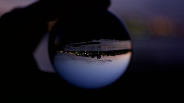 city reflecting in glass ball. sunset - upside down stock videos & royalty-free footage