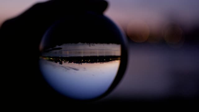 city reflecting in glass ball. sunset - ball stock videos & royalty-free footage
