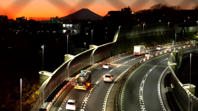 city road highway at dusk with wire mesh fence - autostrada a corsie multiple video stock e b–roll