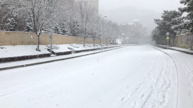 city road in heavy snowfall - condition stock videos & royalty-free footage