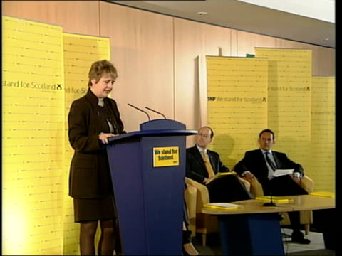 city rooftops int seq two boxers sparring in ring roseanna cunningham msp speech at snp press conference sot in scotland election is being fought out... - scottish national party stock videos & royalty-free footage