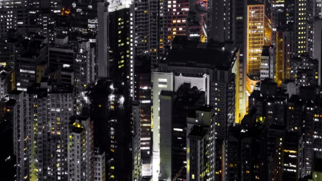 city scape timelapse at night time of hong kong.the building office and cityscape at hong kong and time lapse teamwork of business.the cityscape and life.work late,working late - apse stock videos & royalty-free footage