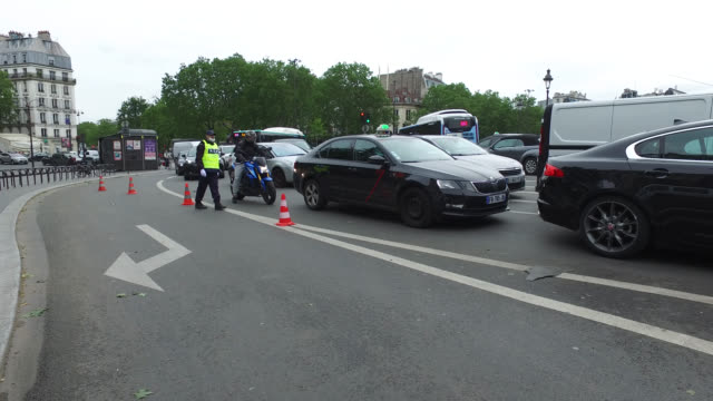 may 11: city security officers block the access to saint antoine street which is now only open to taxis, buses and bicycles, from place de la... - バスティーユ点の映像素材/bロール