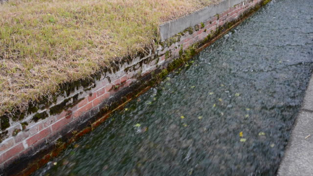 city sewer, watercourse drainage in the city - groundwater stock videos and b-roll footage