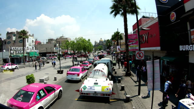 city sightseeing car driving in mexico city street - torre latinoamericana stock videos & royalty-free footage