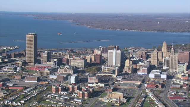 aerial city skyline against lake erie and one hsbc center looming to the side / buffalo, new york, united states - buffalo new york state stock videos & royalty-free footage