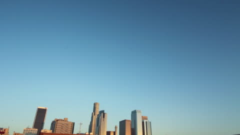 city skyline against perfectly blue sky - tilt down stock videos & royalty-free footage
