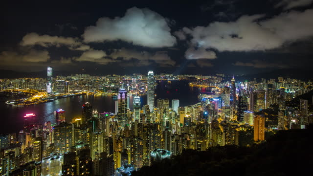 city skyline and victoria harbour viewed from victoria peak, hong kong, china - berg victoria peak stock-videos und b-roll-filmmaterial