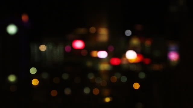city skyline at night, out of focus - defocussed stock videos & royalty-free footage