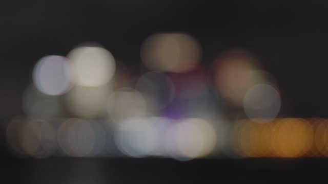 city skyline at night - rack focus stock videos & royalty-free footage