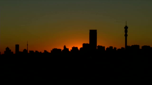 ws ha  city skyline at sunset  / johannesburg/ south africa - image stock videos & royalty-free footage