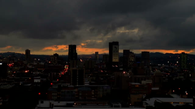 ws city skyline at sunset with heavy grey clouds / pretoria/ south africa - pretoria stock videos & royalty-free footage