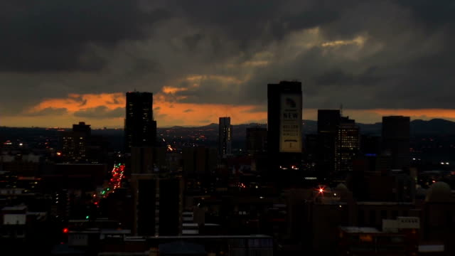 ws zi city skyline at sunset with heavy grey clouds / pretoria/ south africa - pretoria stock videos & royalty-free footage