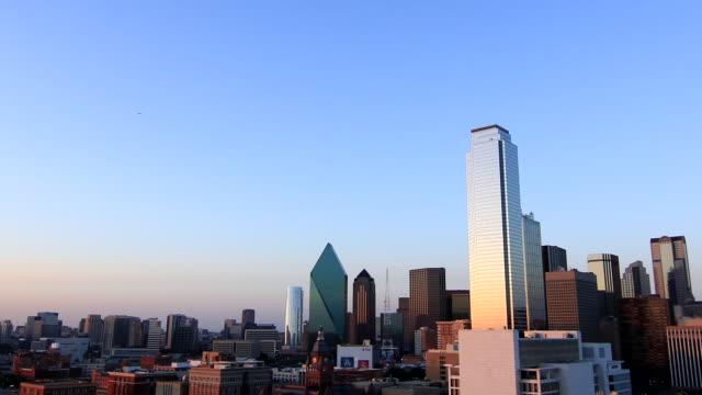City skyline buildings skyscrapers blue sky turning dark Cityscape urban