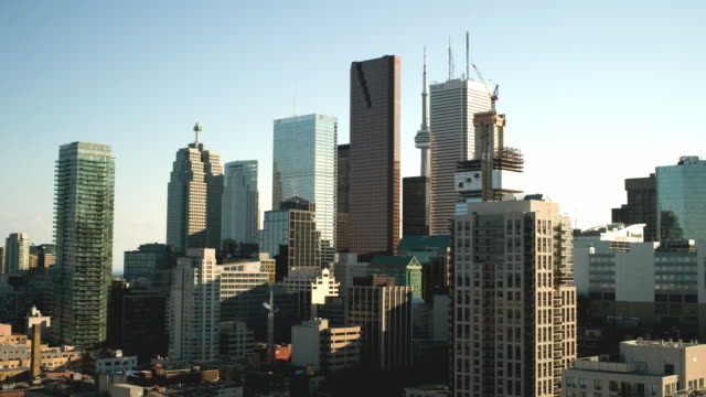stockvideo's en b-roll-footage met t/l ws city skyline from dusk to night with view of scotia tower, cn tower, and first bank tower / toronto, ontario, canada - cn tower