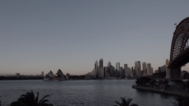 city skyline highrise buildings skyscrapers sydney opera house along sydney harbour harbour bridge right unidentifiable person jogging along... - bennelong point stock videos and b-roll footage