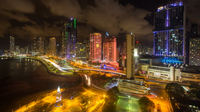 city skyline illuminated at night, panama city, panama, central america - latinamerika bildbanksvideor och videomaterial från bakom kulisserna