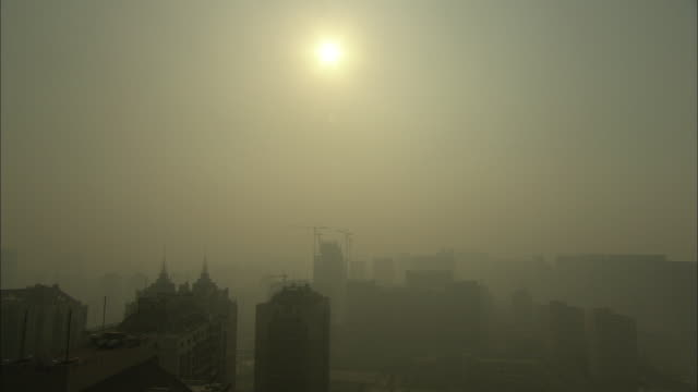 WS HA City skyline in thick smog / Beijing, China