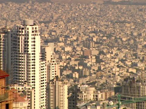 vídeos y material grabado en eventos de stock de ha city skyline of skyscrapers overlooking urban sprawl / tehran, iran - formato buzón