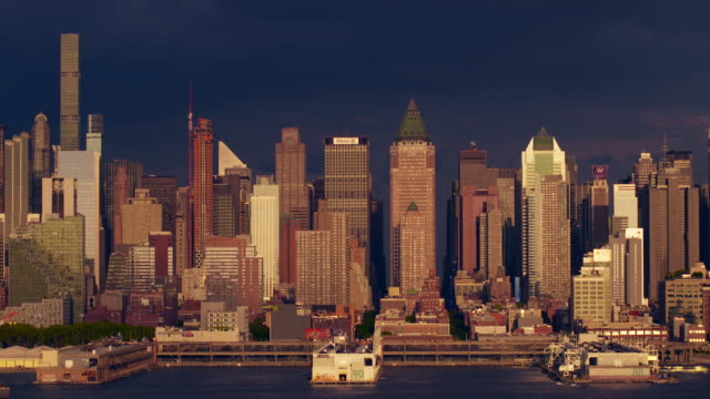 city skyline view of hell's kitchen against a stormy background along the hudson river. - hell's kitchen stock videos and b-roll footage
