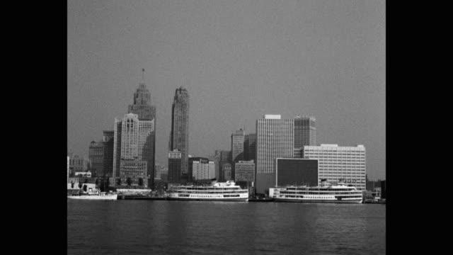 city skyline viewed from detroit river, detroit, michigan, usa - detroit river stock-videos und b-roll-filmmaterial