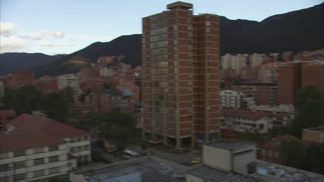 pan city skyline with mountains on the horizon / bogota, colombia - bogota stock videos & royalty-free footage