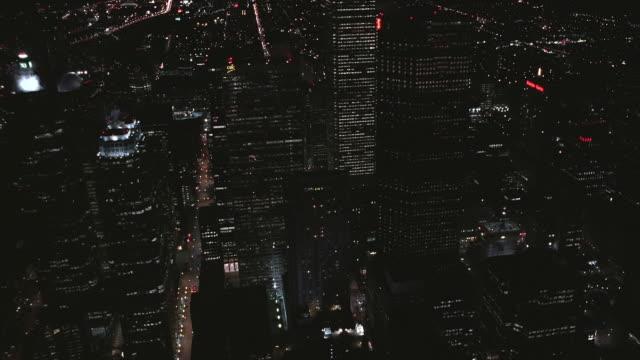 aerial city skyscrapers lit up at night / toronto, ontario, canada - toronto stock videos & royalty-free footage