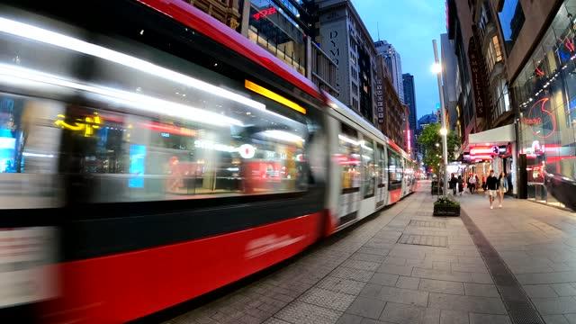 city street at night, blurred motion, tram, people, transport, sydney cbd - traffic time lapse stock videos & royalty-free footage
