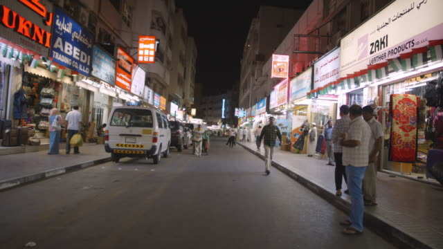 city street at night - deira, dubai - middle east stock videos & royalty-free footage