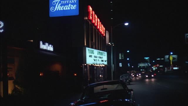 vidéos et rushes de pan city street at night, los angeles - 1971