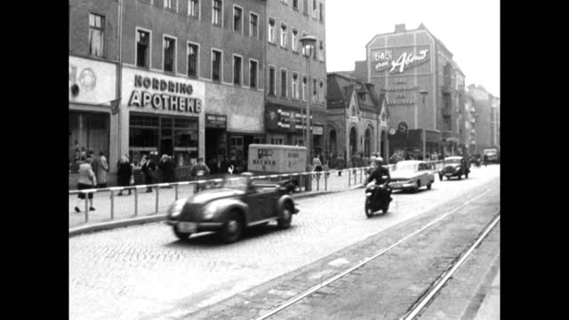 ws city street in east berlin with passing traffic; 1959 - 1950 1959 stock videos & royalty-free footage
