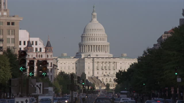 A city street leads to  the the U.S. Capitol Building in Washington, D.C.