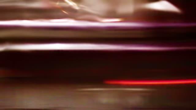 city street lights streak by (loop). - digitale verbesserung stock-videos und b-roll-filmmaterial