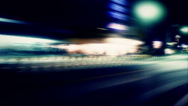 City street lights streak by (Loop).