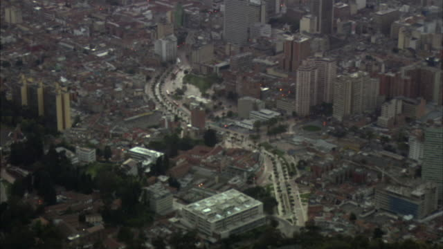 AERIAL WS City street near downtown office buildings / Bogota, Colombia