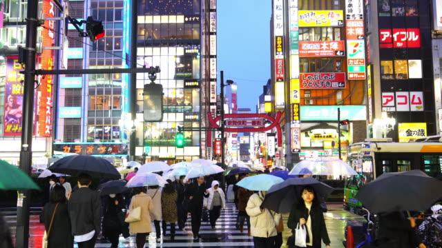 City street night life with crowd people in Shinjuku
