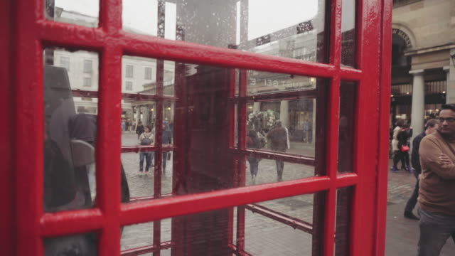 city street of london - public phone stock videos & royalty-free footage