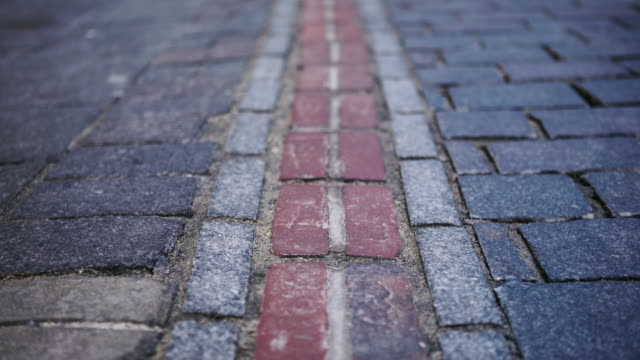 city street paved bricks - cobblestone stock videos and b-roll footage