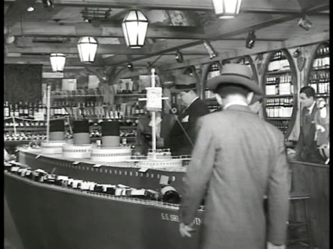 city street pedestrians 'sherry' liquor store int ws americans in liquor store cu man picking up french wine 'vintage 1940' cu wine being wrapped at... - 1946 stock videos and b-roll footage