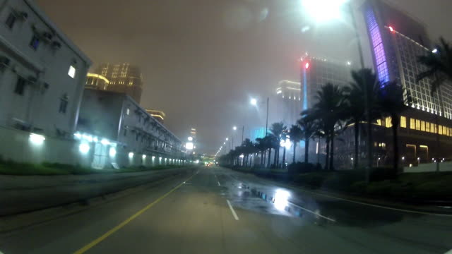 City street Sands Cotai Central entertainment complex towers warehouse row of palm trees Plaza Macao pedestrian overpass The Venetian Macao...