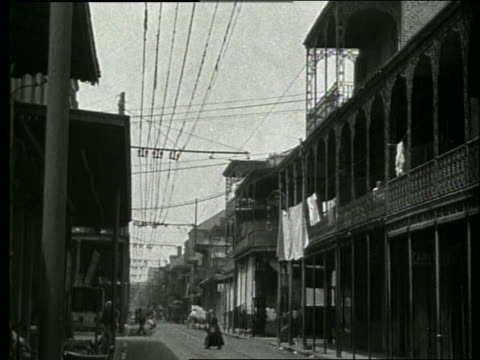 b/w city street with balconies on buildings / new orleans / 1915 / no sound - new orleans stock videos & royalty-free footage