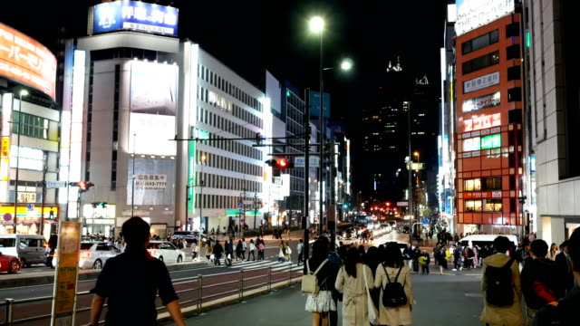 city street with crowd people in shinjuku, japan - asian market stock videos and b-roll footage