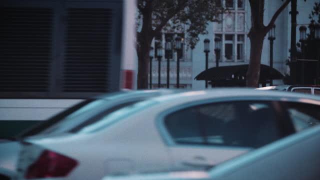 city streets at dusk - general motors stock videos & royalty-free footage