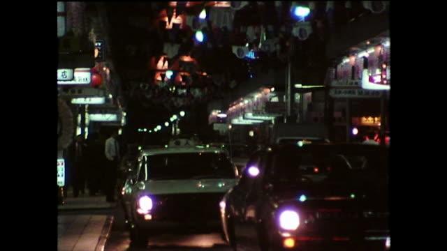 stockvideo's en b-roll-footage met ws city streets at night in hiroshima, japan; 1975 - establishing shot