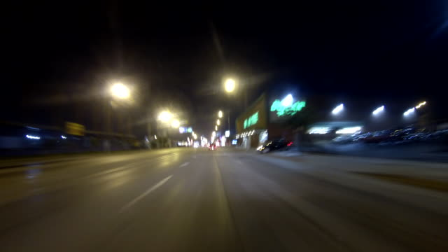 city streets streetlights traffic lights lowrise buildings w/ storefronts gas station highway freeway expressway road signs urban - inglewood video stock e b–roll