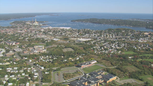 aerial city suburbs rolling into massachusetts bay / salem, massachusetts, united states - salem massachusetts stock videos & royalty-free footage